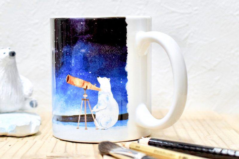 天体観測するシロクマのマグカップ